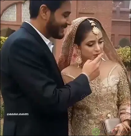bride smoking with groom